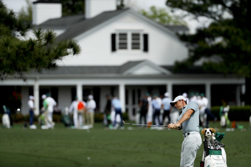 Rory McIlroy, of Northern Ireland, practices on the driving range at the Masters golf tournament Tuesday in Augusta, Ga.
