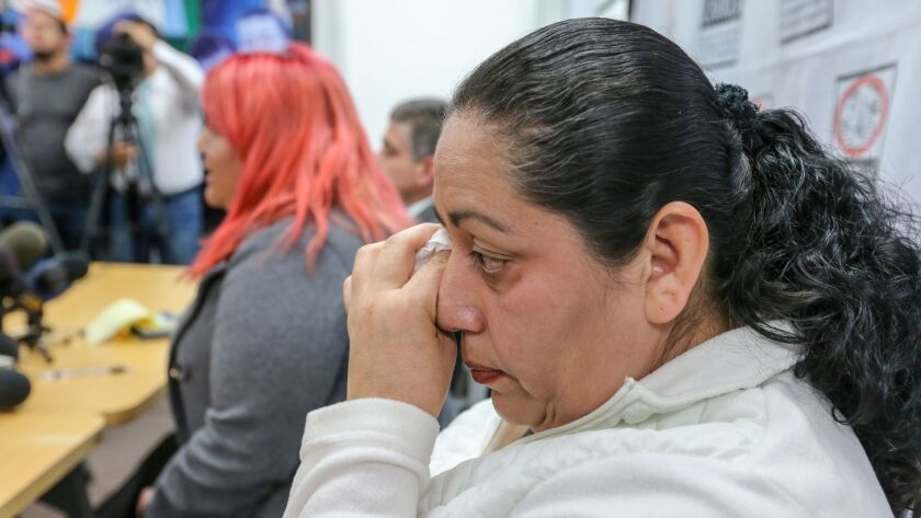 Rosa Robles, mother of Jesus Alonso Arreola Robles, wipes her tears at a news conference in Los Angeles on Thursday.