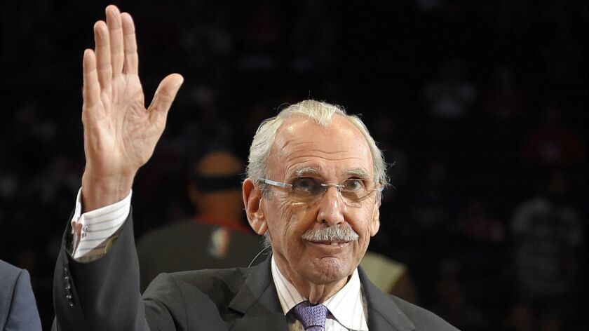 Ralph Lawler waves to Clippers fans as he is honored during halftime against Washington on April 3, 2016.
