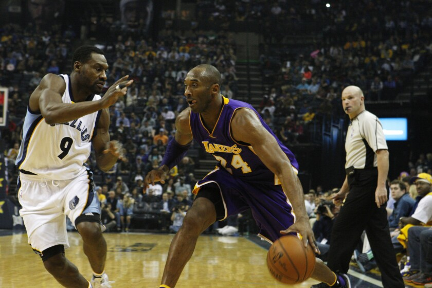 Lakers guard Kobe Bryant drives against Grizzlies guard Tony Allen in the first half Sunday.