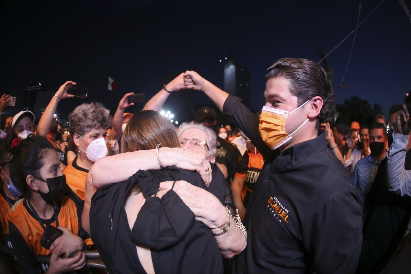 YouTuber Mariana Rodríguez and Samuel Garcia, the newly-elected governor of Nuevo Leon attend their victory celebration at the Macroplaza of Monterrey, in Nuevo Leon state, Mexico, Monday, June 7, 2021. Garcia, 33, is a baby-faced former senator whose blond wife, YouTuber Mariana Rodríguez, is better known for posting videos of herself giving makeup tutorials or clutching a small dog. (AP Photo/Roberto Martinez)