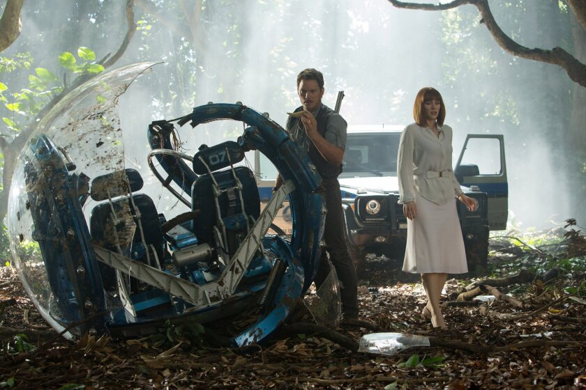 "Chris Pratt and Bryce Dallas Howard assess the damage in ""Jurassic World."""
