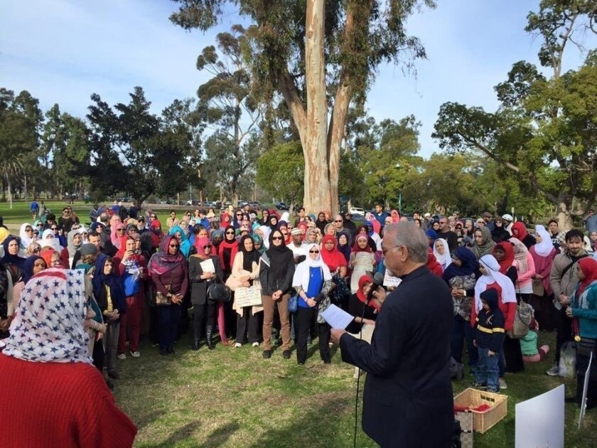 Hundreds wearing hijabs gathered in Balboa Park Monday to stand in solidarity with Muslim women.