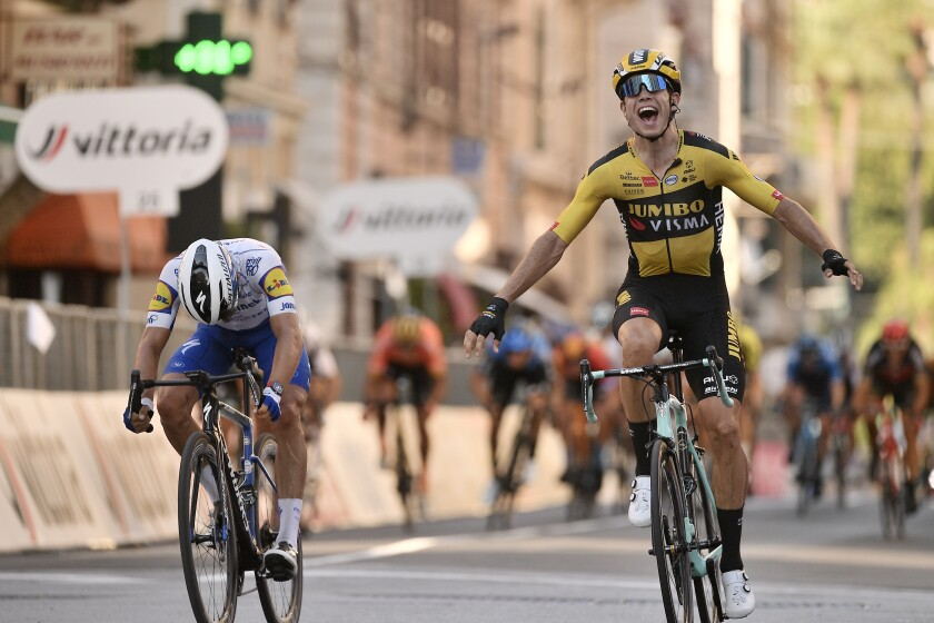 Belgium's Wout Van Aert, right, sprints ahead of France's Julian Alaphilippe to win the Milan to Sanremo cycling race, in San Remo, Italy, Saturday, Aug. 8, 2020. (Marco Alpozzi/LaPresse via AP)