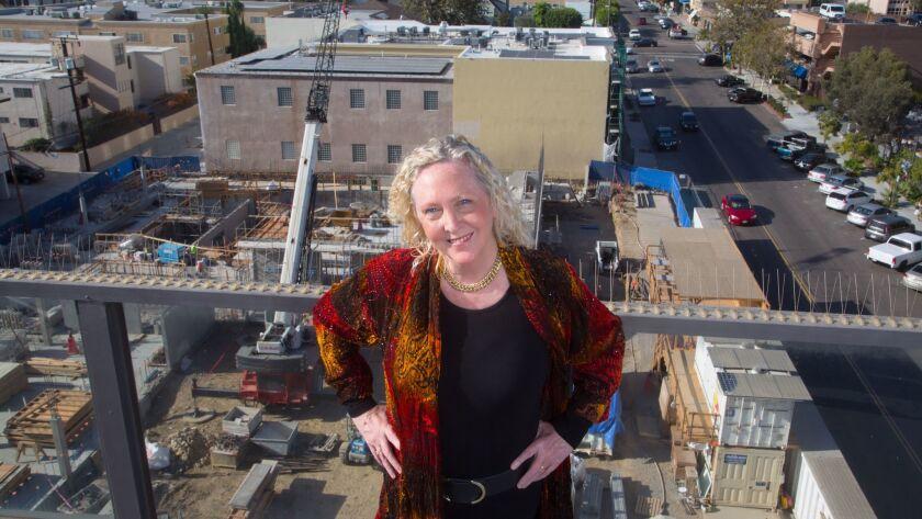 Kristin Lancino, president and artistic director of the La Jolla Music Society, stands near the society's future home, the Conrad Prebys Performing Arts Center in La Jolla.