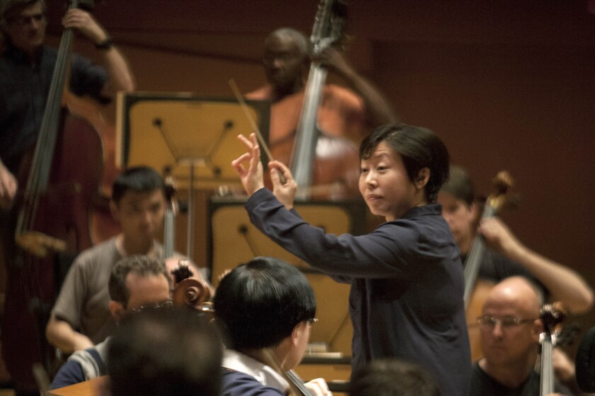 Conductor Xian Zhang directs musicians during a 'Chinese New Year: From Tchaikovsky to Tan Dun' rehearsal at Disney Concert Hall in Los Angeles.