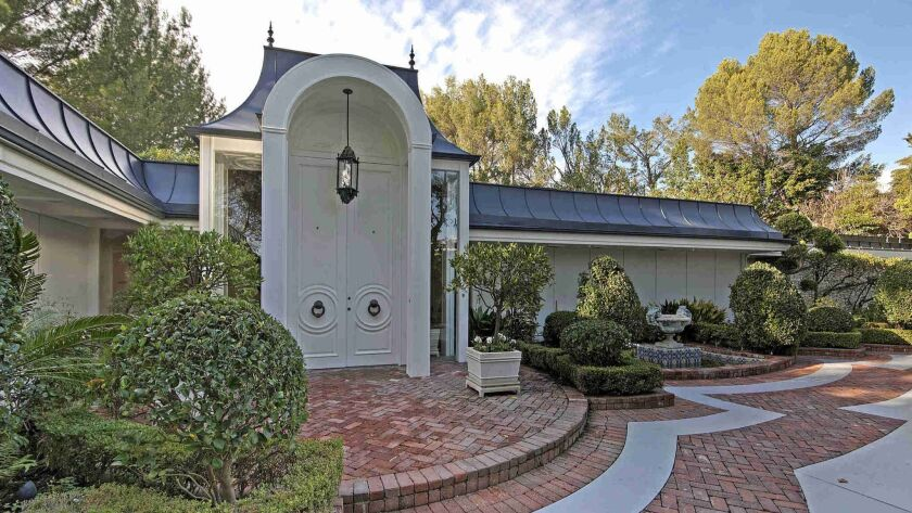 The gated compound in the Trousdale section of Beverly Hills was once owned by Elvis Presley and his wife, Priscilla.