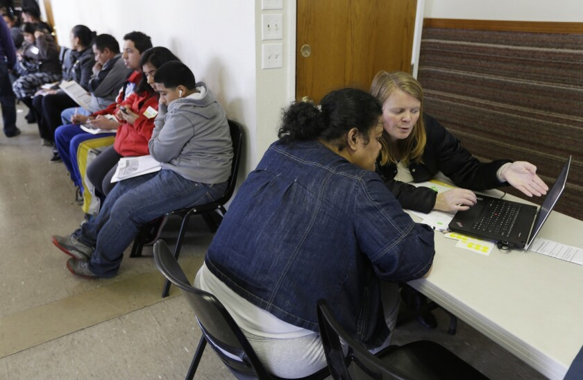 Overall, during the final month of enrollment in March, 416,000 Californians signed up for health insurance plans -- making it the most successful month on record for the state exchange. Above, an enrollment event at the Bay Area Rescue Mission last month.