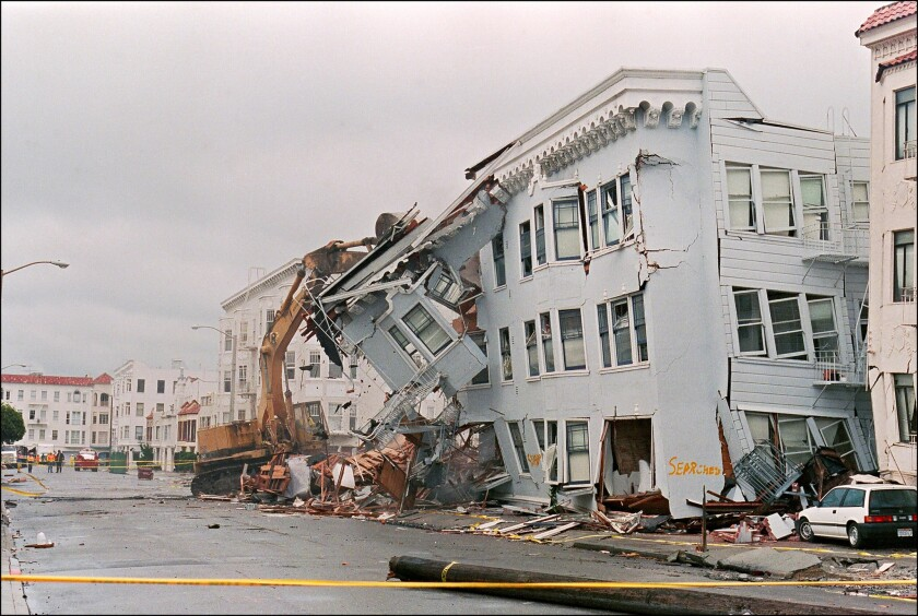 The front of an apartment building in the Marina District in San Francisco collapsed in the 1989 Loma Prieta earthquake.