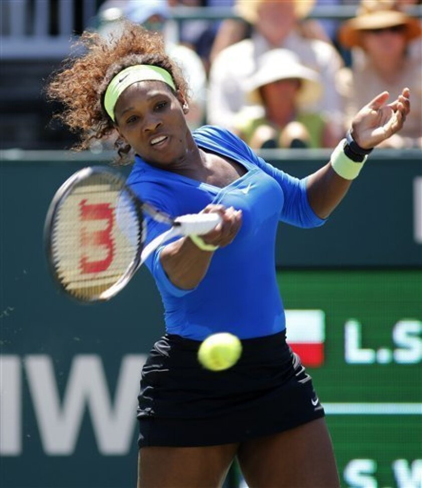 Serena Williams hits a shot to Lucie Safarova, of the Czech Republic, during the final at the Family Circle Cup tennis tournament in Charleston, S.C., Sunday, April 8, 2012. Williams won 6-0, 6-1. (AP Photo/Mic Smith)