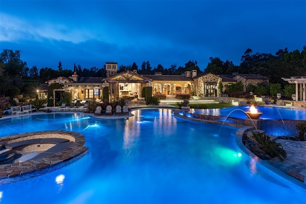 The Tuscan-style estate sits on more than five acres of grounds in Rancho Santa Fe. Among features are indoor and outdoor sports courts, a resort-style swimming pool and 13,000 square feet of living space.