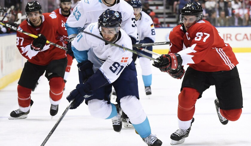 Canada's Sidney Crosby, right, chases Europe's Frans Nielsen during the third period of Game 1 of the World Cup of Hockey final in 2016.