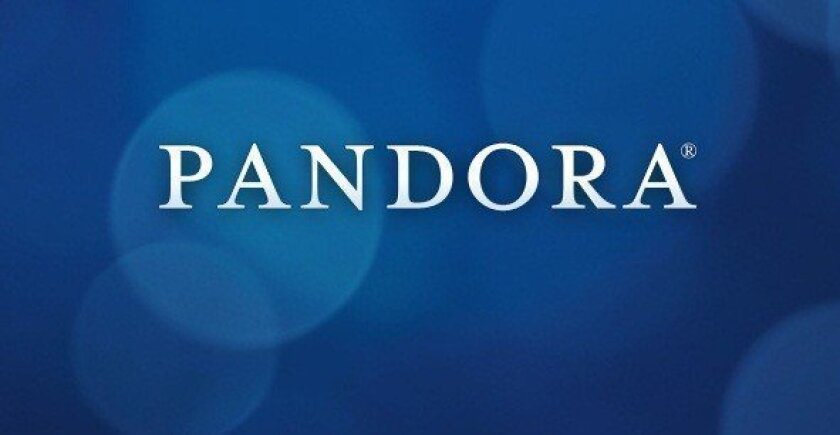 Pandora Media Inc. shares continued to tumble Tuesday after reports that Apple is getting closer to launching a rival music streaming service.
