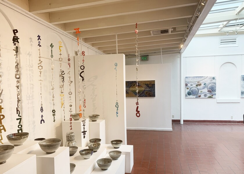 """""""Rhythm of Language"""" and """"Fellowship of Language"""" installation by ceramicist Young Shin Kim."""