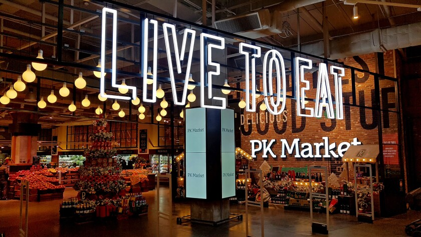 PK Markets like this one in Korea sell groceries and serve food.