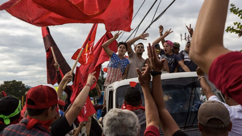 Supporters of presidential candidate Salvador Nasralla chant slogans against Honduran President Juan
