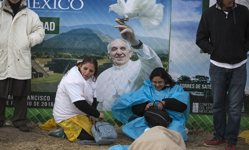 Hundreds slept outside overnight to wait for Pope Francis to arrive in Ecatepec, Mexico, on Feb. 14.