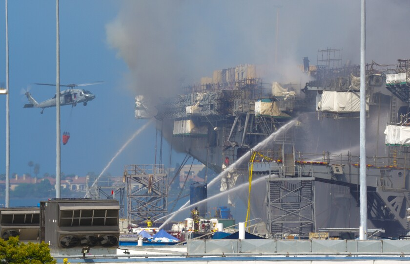 The Navy used helicopters for water drops over the fire aboard the Bonhomme Richard in San Diego.