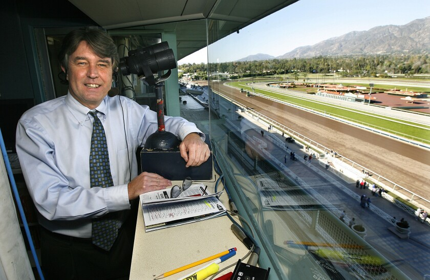 Trevor Denman stands in the booth where he calls the races at Santa Anita racetrack in 2007. Denman on Friday announced his decision to retire.