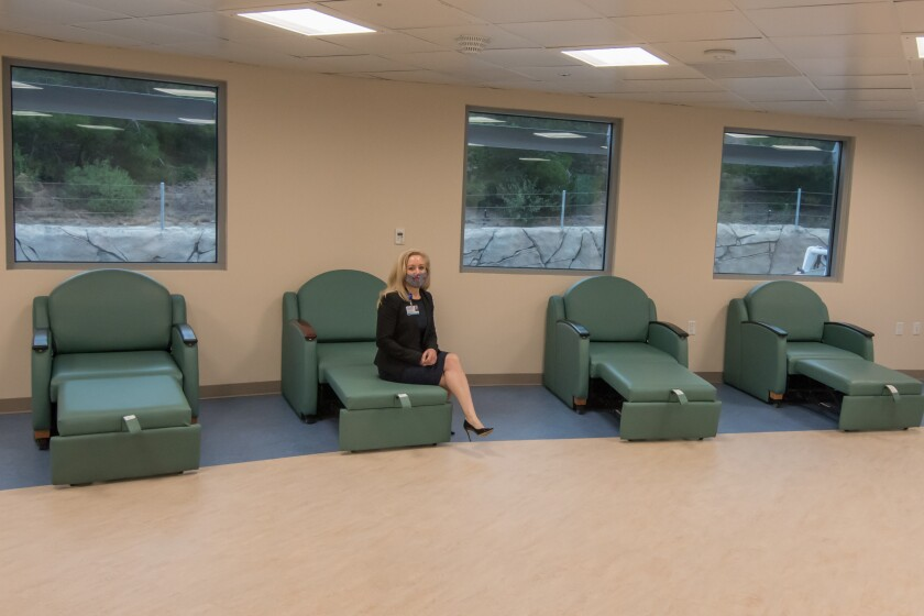 Diane Hansen, chief executive officer of Palomar Health, sits on a recliner in the new crisis stabilization unit.