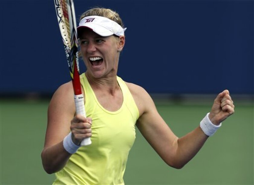 Alison Riske reacts after beating Petra Kvitova, of the Czech Republic, during the third round of the 2013 U.S. Open tennis tournament, Saturday, Aug. 31, 2013, in New York. (AP Photo/Julio Cortez)