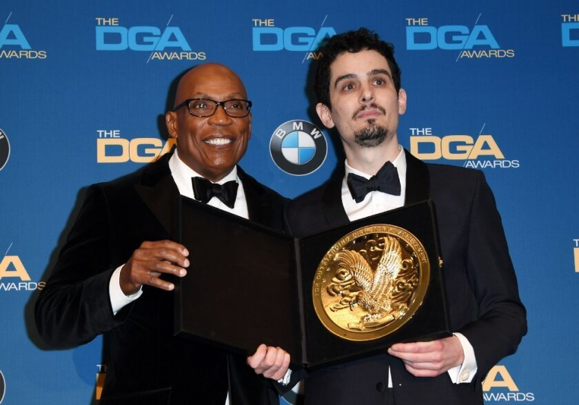 DGA President Paris Barclay, left, with director Damien Chazelle, winner of the feature film prize at the 69th Directors Guild of America Awards on Saturday night.