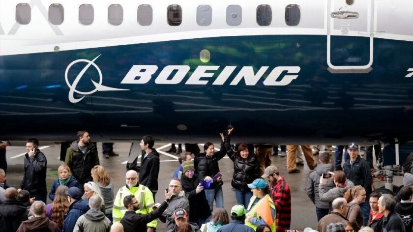 A Boeing 737 MAX 7, the newest version of Boeing's fastest-selling airplane, is displayed Feb. 5, 2018, during a debut for employees and media of the new jet in Renton, Wash. The Boeing Co. reported earnings Jan. 30, 2019, with numbers that beat Wall Street predictions.