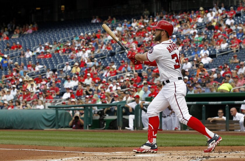 Washington Nationals' Bryce Harper watches his three-run home run during the first inning of a baseball game against the Milwaukee Brewers at Nationals Park, Wednesday, July 6, 2016, in Washington. (AP Photo/Alex Brandon)