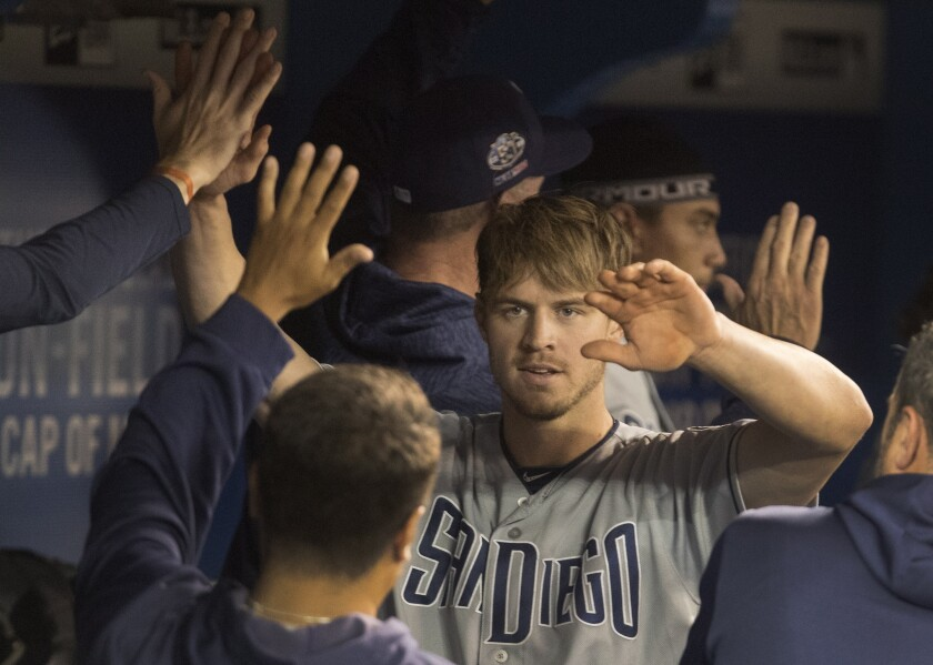 Wil Myers is greeted in the dugout after hitting a two-run home run against the Toronto Blue Jays on Saturday.