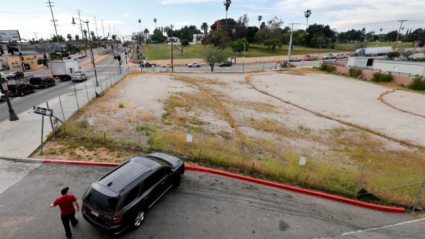 An empty lot at the intersection of 1st and Lorena streets in Boyle Heights, where a nonprofit developer plans to build housing for homeless and low-income people.