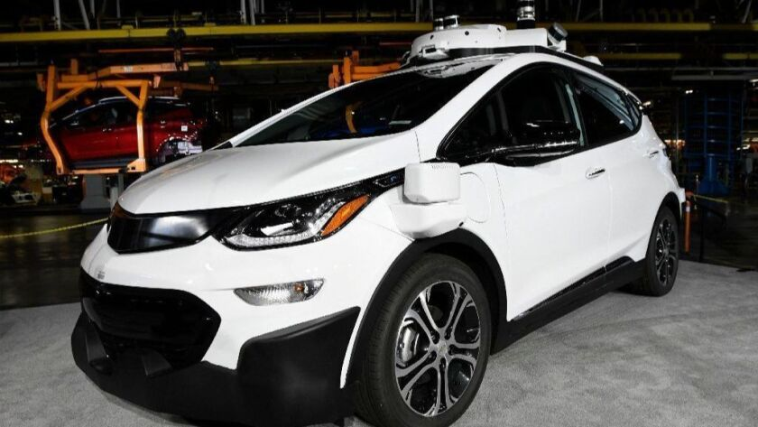 A self-driving Chevrolet Bolt EV is displayed June 13, 2017, at GM's Orion Assembly in Lake Orion, Mich. General Motors and Honda have announced they are joining forces on autonomous vehicles technology.