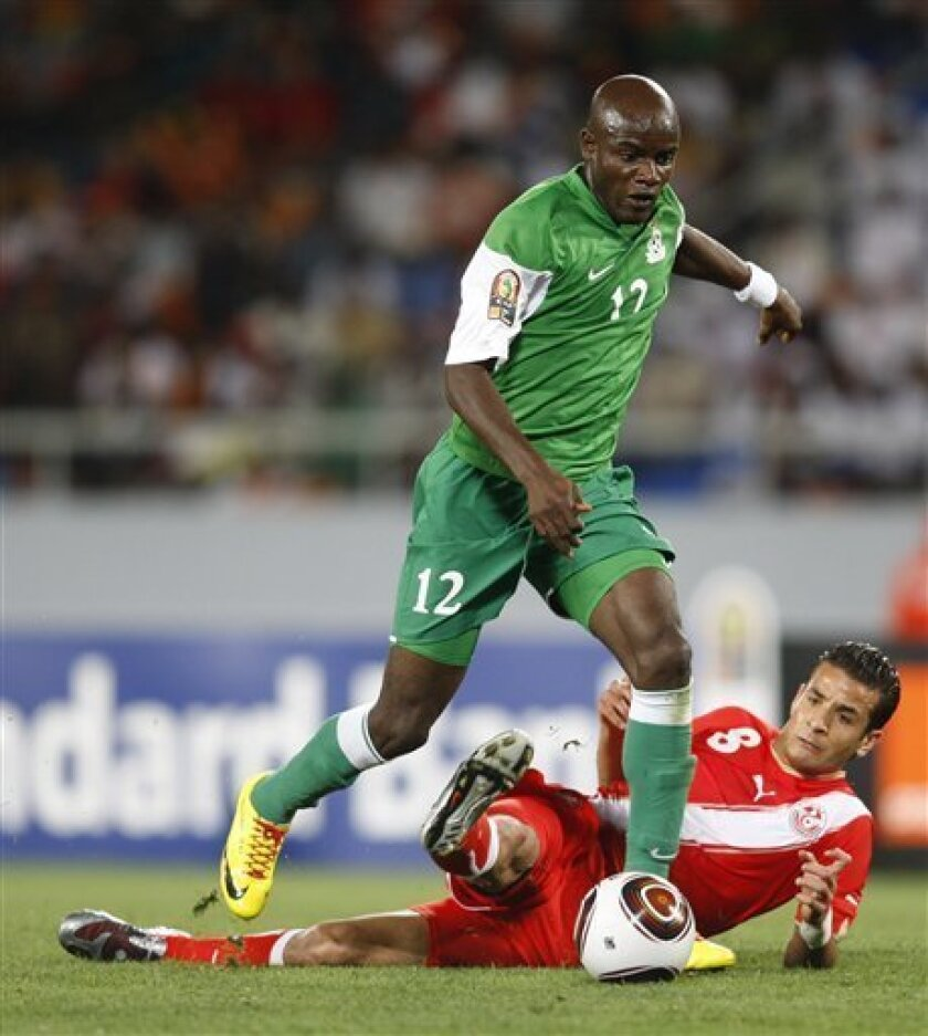 Zambia's James Chamanga gets past Tunisia's Khaled Korbi during their African Cup of Nations Group D soccer match at Tundavala Stadium in Lubango, Angola Wednesday, Jan. 13, 2010. (AP Photo/Rebecca Blackwell)