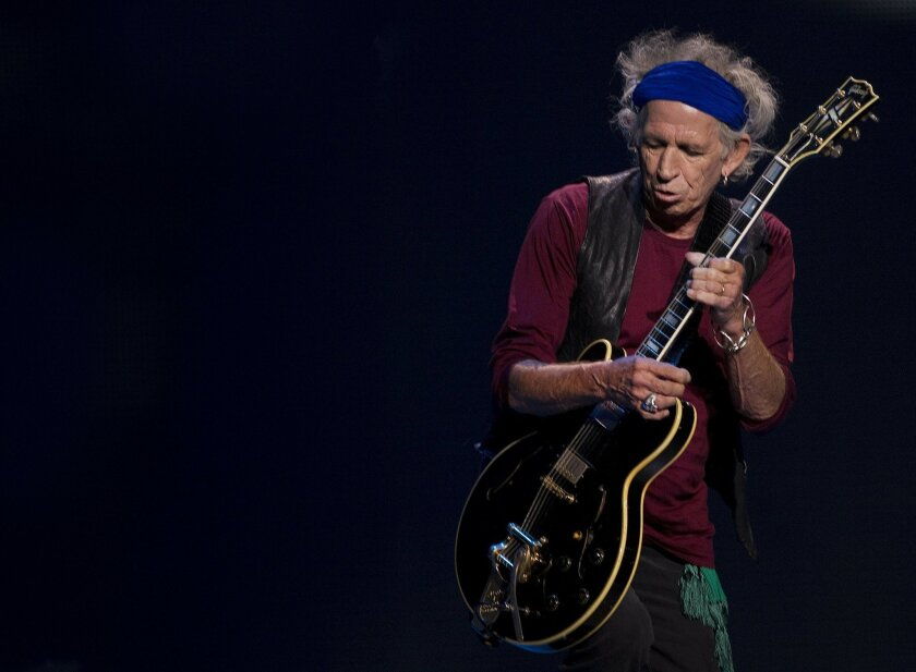 Keith Richards, lead guitarist for the Rolling Stones, always a showman.