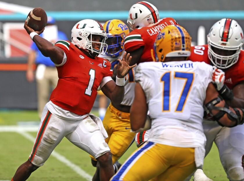 Miami quarterback D'Eriq King (1) passes against Pitts in the second half of an NCAA college football game in Miami Gardens, Fla., Saturday, Oct. 17, 2020. (Al Diaz/Miami Herald via AP)
