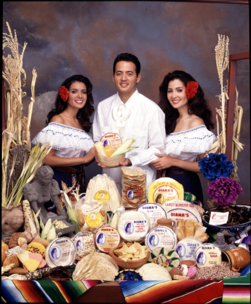 Tensha, Sam Jr. and Diana Magaña appear in a 1994 publicity photo for Diana's Mexican Food Products.