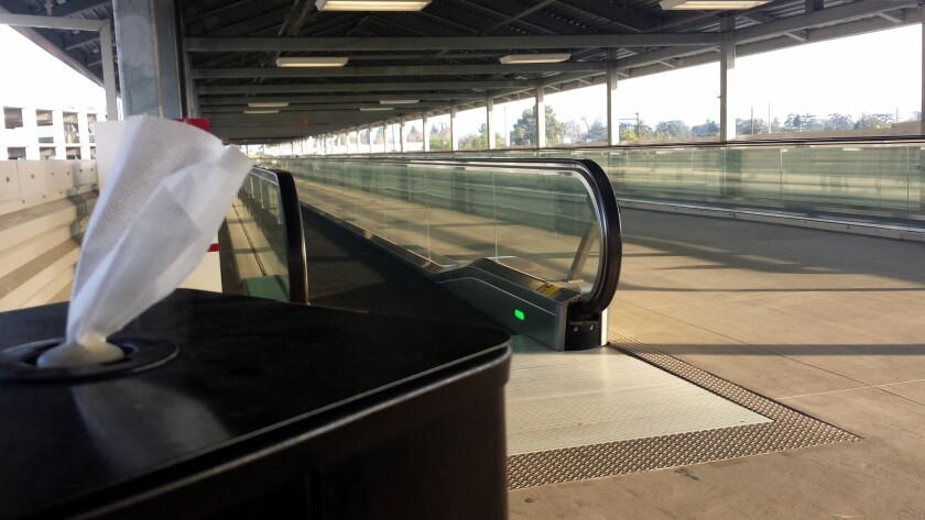 For two years, handrails at the airport's moving walkways have been coating visitors' hands with black residue.