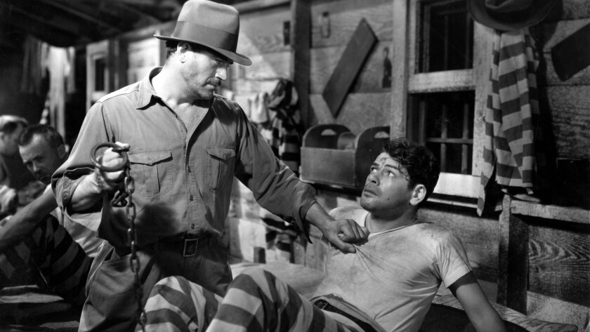 "Actor Paul Muni (right) in a scene from the 1932 film ""I Am A Fugitive From A Chain Gang."""