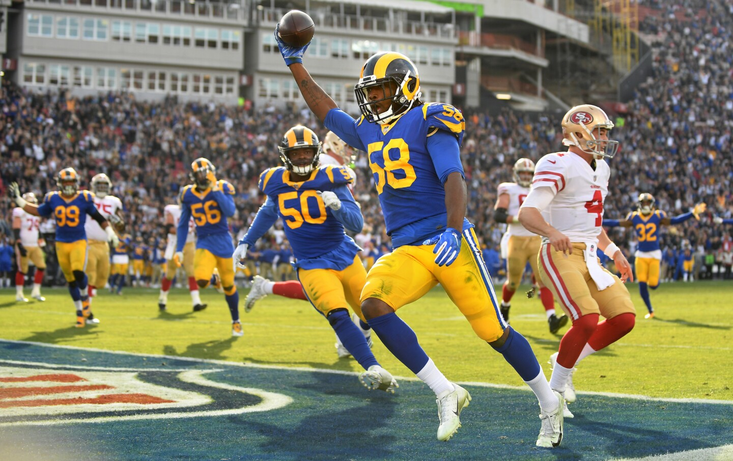 Rams linebacker Cory Littleton beats 49ers backup quarterback Nick Mullens (4) to the end zone while returning an interception for a touchdown last season.