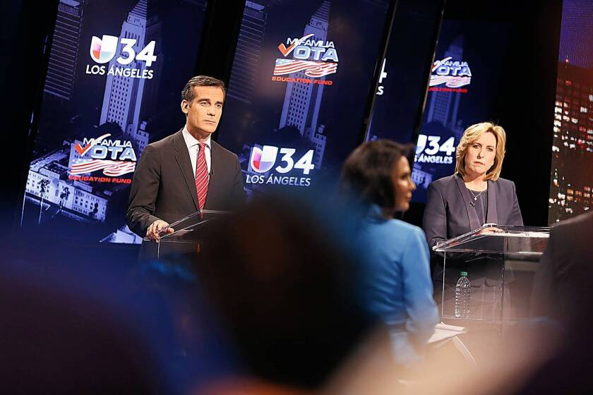 L.A. mayoral candidates Eric Garcetti and Wendy Greuel spar in a debate that was televised live from Spanish-language KMEX-TV (Channel 34) in Los Angeles. A month before the May 21 runoff, Garcetti has opened a commanding 10-point lead over Greuel, according to a new USC Price/Los Angeles Times poll.