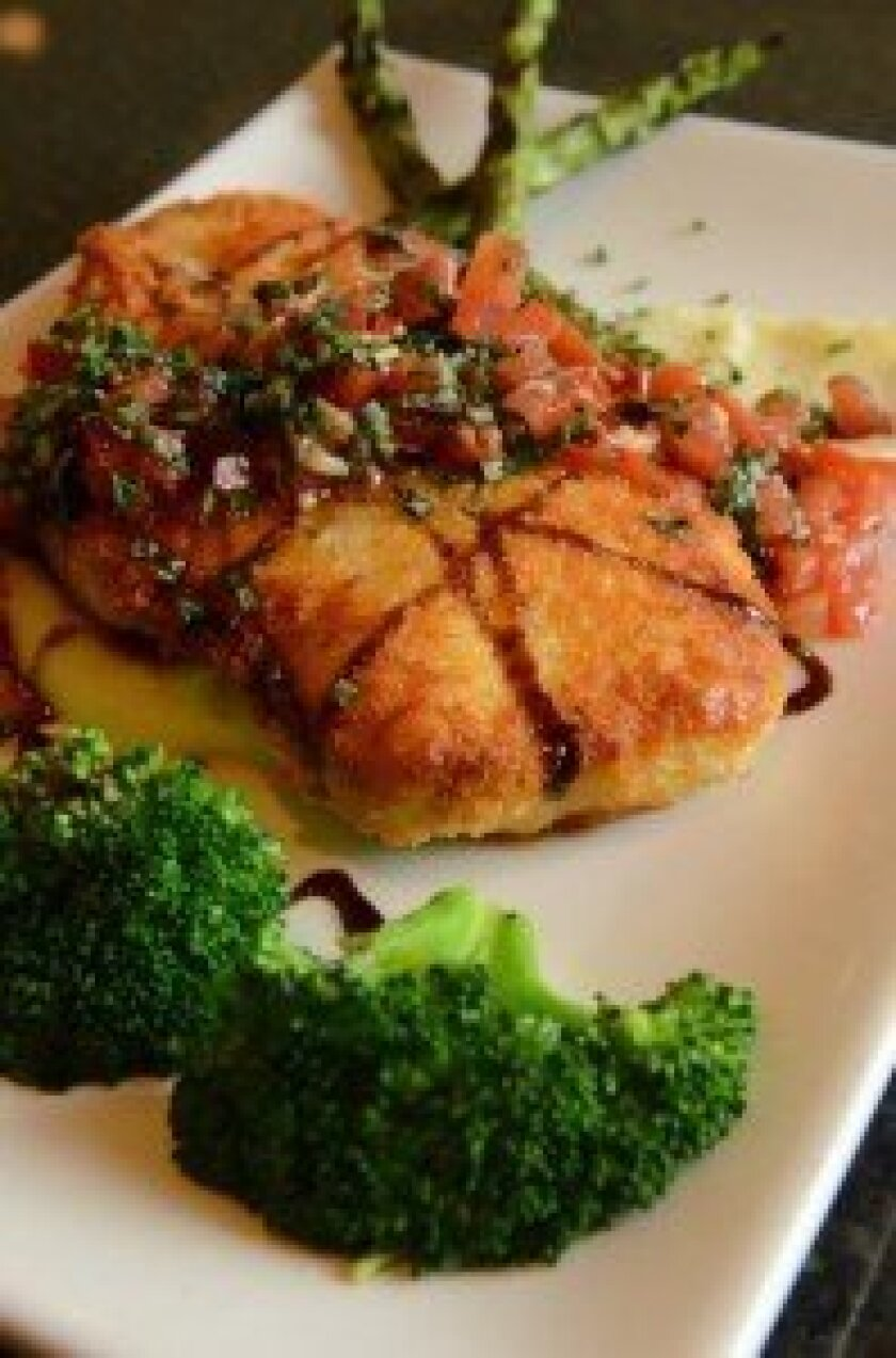 Parmesan Chicken Bruschetta features chicken breast coated with parmesan cheese and roasted tomato bruschetta.