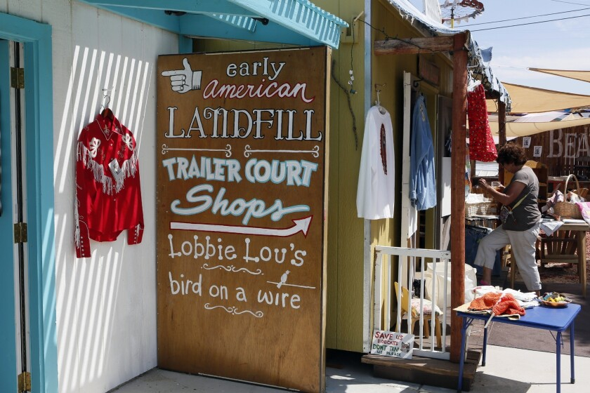 Is it a style? A period? A store? All of the above? Early American Landfill sells clothing, cards and art.