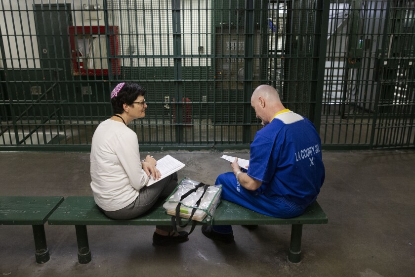 Avivah Erlick, a Jewish chaplain, visits inmates at Men's Central Jail in downtown Los Angeles.