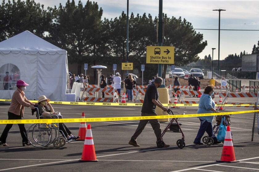 Orange County active Phase 1A residents exit large tents at Orange County's first large-scale vaccination site
