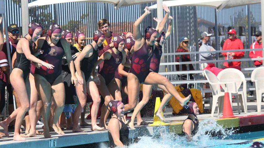 Point Loma celebrates the team's San Diego Section Division III title last season.