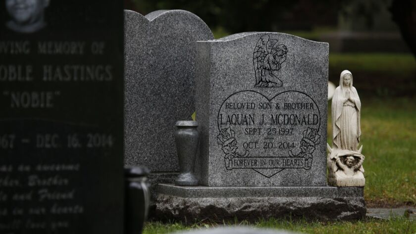 A tombstone marks the grave of Laquan McDonald at the Forest Home Cemetery in Forest Park, Ill., on