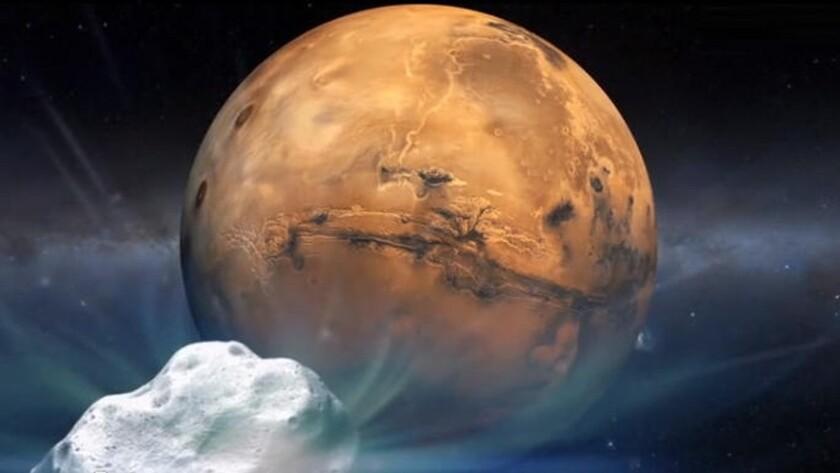 An artist's concept shows comet Siding Spring (C/2013 A1) heading toward Mars.