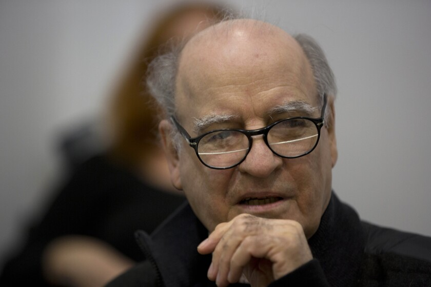 """FILE - In this May 21, 2014 file photo, Argentine cartoonist Joaquin Salvador Lavado, better known as """"Quino,"""" gives a press conference in Buenos Aires, Argentina. Lavado passed away on Wednesday, Sept. 30, 2020, according to his editor Daniel Divinsky who announced it on social media. (AP Photo/Eduardo Di Baia, File)"""