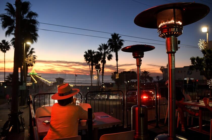 Customers dined along Manhattan Beach Boulevard before the shutdown in December.