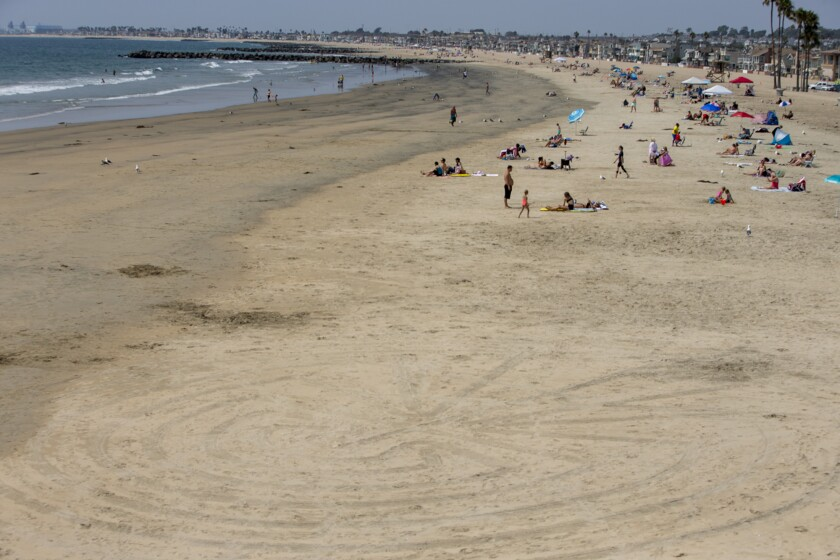 A large maze is carved into the sand near the Newport Beach Pier on Aug. 23.