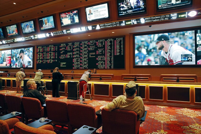 People make bets in the sports book at the South Point hotel and casino in Las Vegas in 2018.